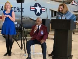 Frank Macon and Liz Harper speaking in front of an Air Force jet