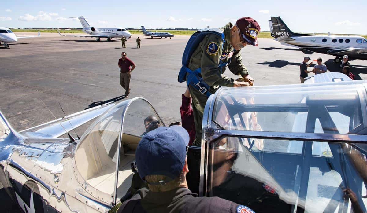 Frank climbing into the T-6 Texan Airplane